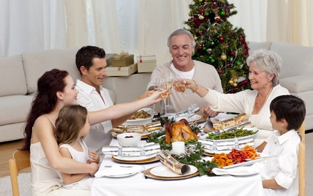 Family tusting in a Christmas dinner photo