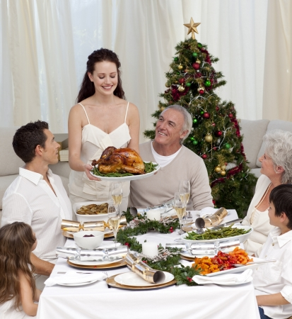 Mother showing turkey to her family for Christmas photo