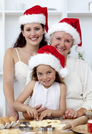Daughter, mother and grandmother baking Christmas cakes Stock Photo - 10259342