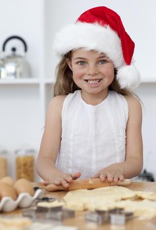 Family baking Christmas cakes in the kitchen Stock Photo - 10258590