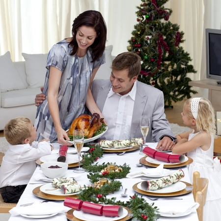 Parents and children in Christmas dinner with turkey Stock Photo - 10259042