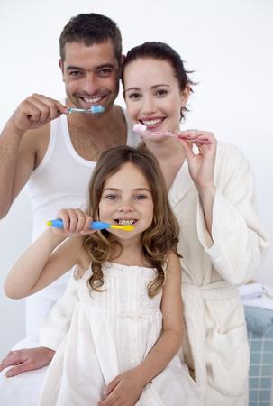 couple bathroom: Family cleaning their teeth in bathroom