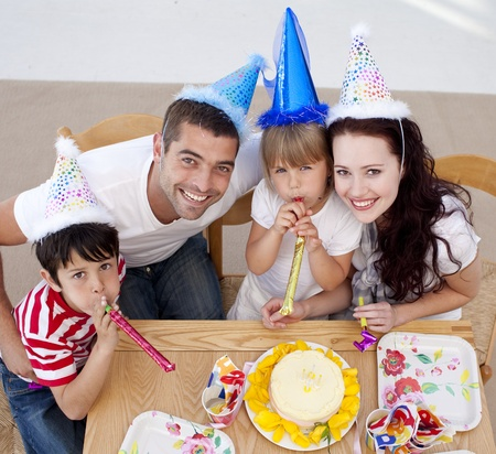 Little girl celebrating her birthday with her family photo