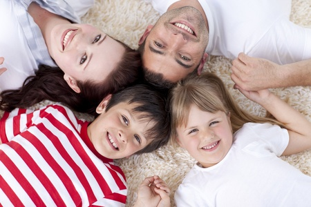 head home: Family on floor with heads together Stock Photo