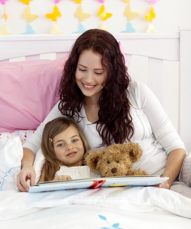 Mother and daughter reading in bed Stock Photo - 10235183