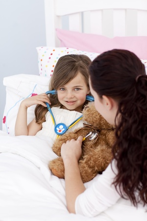 Mother and daughter playing with a stethoscope photo