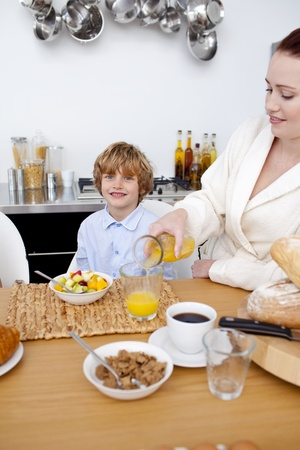 Kid having breakfast with his mother Stock Photo - 10257247