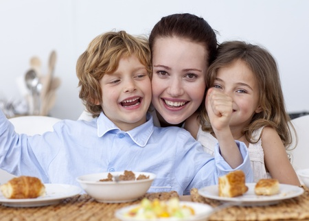 Children and mother having fun in breakfast Stock Photo - 10258144