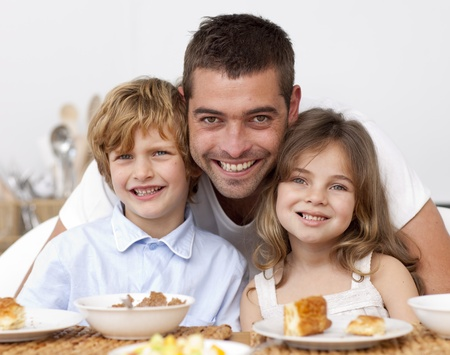 Children having breakfast with their father photo