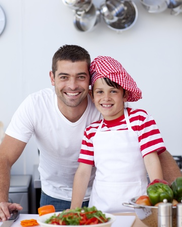 Father and son cooking a salad photo