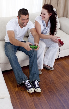 Frineds playing video games in living-room photo