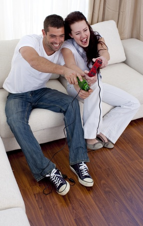 game over: Couple having fun playing video games in living-room Stock Photo