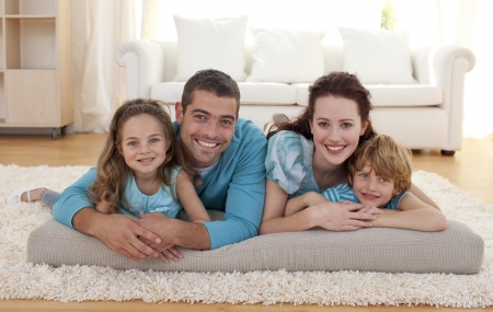 family living: Family on floor in living-room