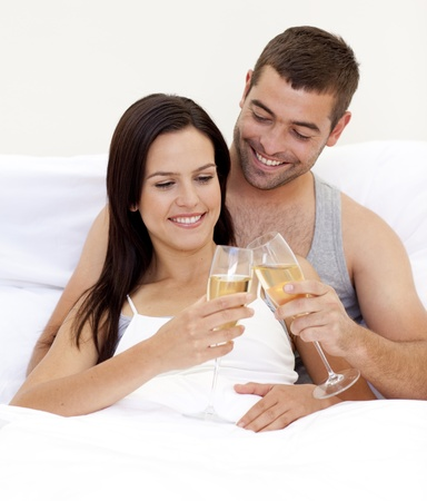 Couple clebraitn their love with champagne photo