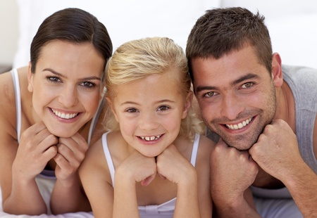 Lovely parents with their little daughter photo