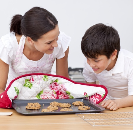 home baking: Mother and son looking at home-made biscuits Stock Photo