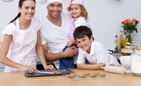 Smiling family baking in the kitchen Stock Photo - 10258525