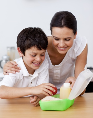 Mother and son making the school lunch Stock Photo - 10257001