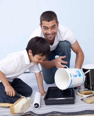 Father and son painting a bedroom photo