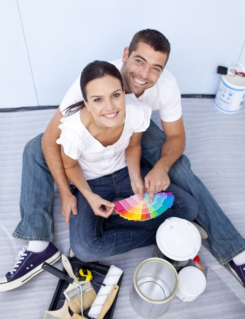 decorating: High angle of couple chosing colours to paint new house
