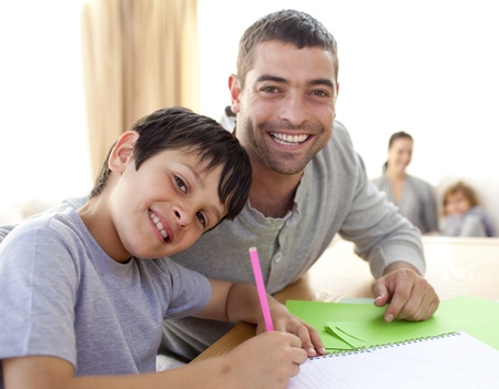 Boy painting with his father at home Stock Photo - 10244410