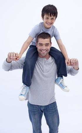 Father giving son piggyback ride photo