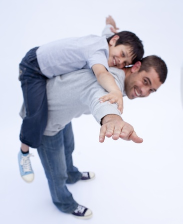 piggyback ride: Father and son playing together Stock Photo