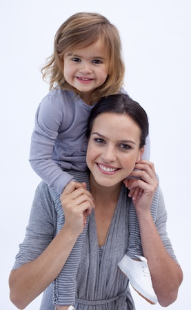 modern parents: Mother giving her daughter piggyback ride Stock Photo