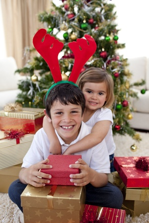 Happy brother and sister celebrating Christmas photo