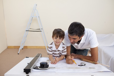 Father and son studying architecture at home Stock Photo - 10258583