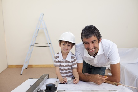 Smiling dad and little boy studying architecture photo
