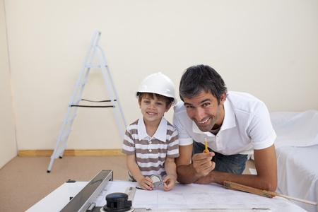 Father and son refurbishing a bedroom photo