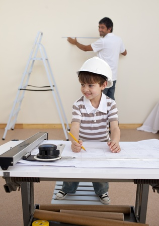 Father and son studying architecture at home Stock Photo - 10258624