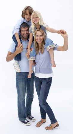 Happy family giving children piggyback ride photo