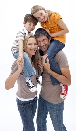 Mother and father giving children piggyback ride