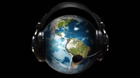 Ear Phones and ear Piece around a Globe photo