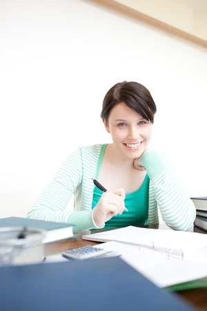 Happy young woman studying  photo