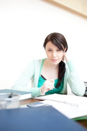 Charming teen girl studying  photo