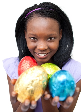 Smiling ethnic woman showing Easter eggs  photo