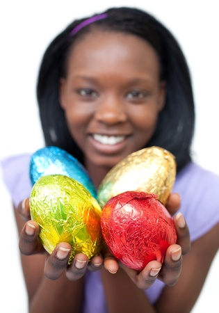 Happy ethnic woman showing Easter eggs  photo