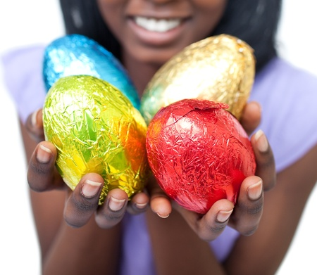 Close-up of a woman showing colorful Easter eggs photo
