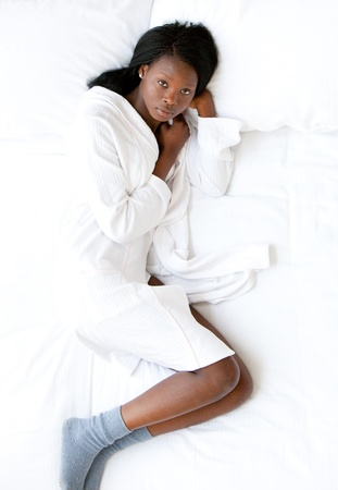 Afro-American woman lying on her bed photo