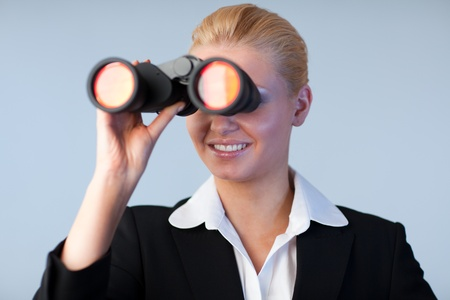 Happy business woman looking outwards Stock Photo - 10258610