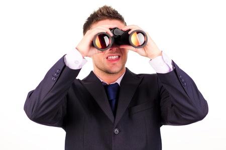 looking ahead: Man looking through binoculars  Stock Photo