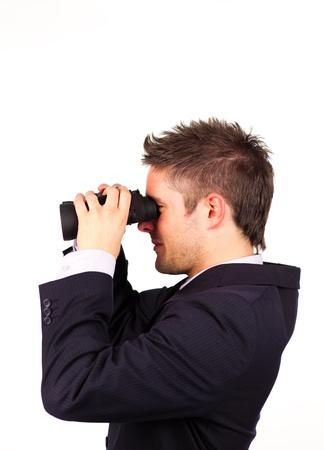 man looking through Binoculars photo