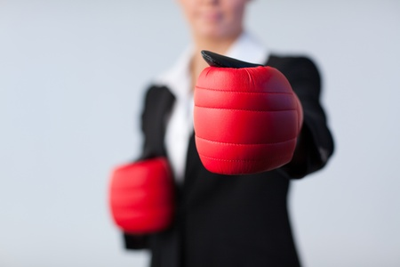Business woman with boxing gloves on Stock Photo - 10258742