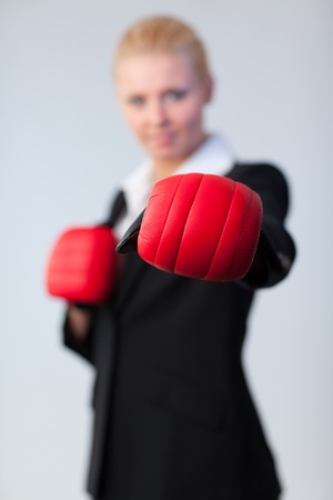 woman showing boxing glove to the camera Stock Photo - 10258723
