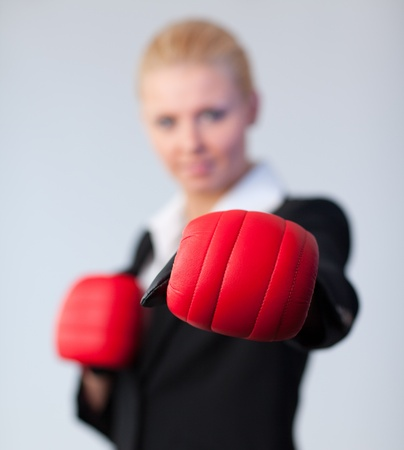 woman showing boxing glove to the camera Stock Photo - 10244309