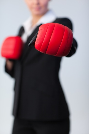 woman showing boxing glove to the camera Stock Photo - 10257980