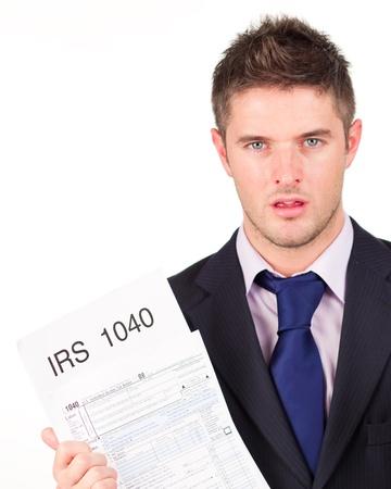 podatnika: Człowiek trzyma się jego zwrotu Formularz IRS Zdjęcie Seryjne